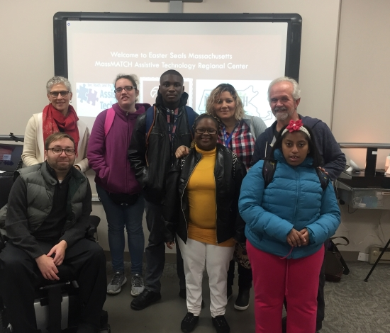 Students and staff in front of smart board