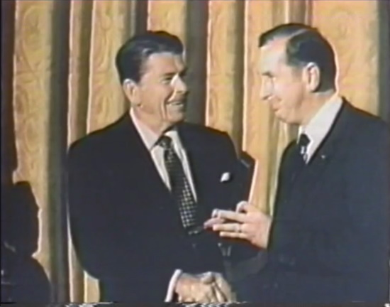 Ronald Reagan shaking hands with Dr. Cory.